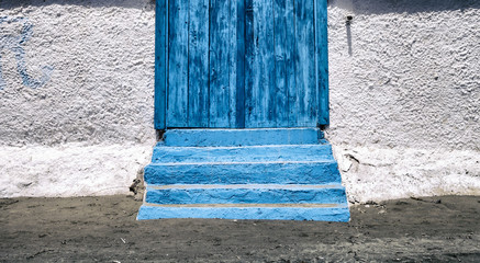 Blue entrance door to the beach house