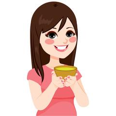 Beautiful young brunette Asian woman having healthy green tea