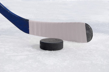 ice hockey stick with white tape and puck