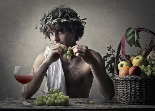 Bacchus holding a bunch of grapes