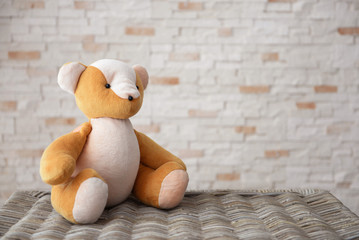 Kid's toy on brick wall background