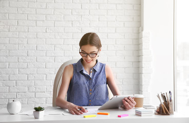 Woman working with sketches at office