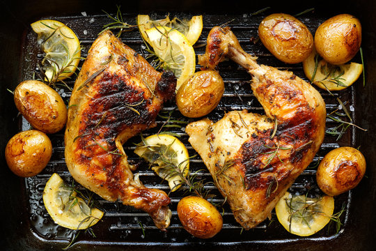 Grilled rosemary lemon  chicken quarters with roasted  potatoes