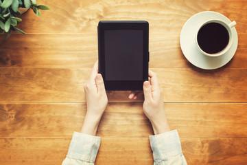 Person reading a book with an e-reader