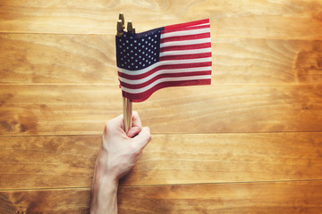 Person holding an American flag