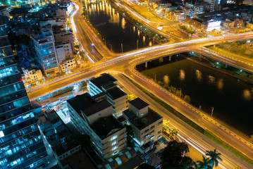 Skyline of Ho Chi Minh city by night with trails of lights, Viet