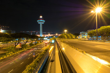 Singapore Changi Airport at night with air traffic control tower