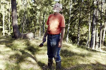 Senior man in forest
