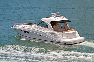 Small motor yacht cruising the florida intra-coastal waterway near miami beach.