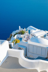 White building against blue sky and sea in Santorini island, Oia, Greece