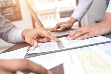 Image of male hand pointing at business document during discussi