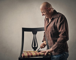 Man trying to fix a chair