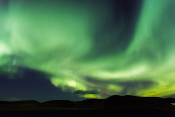 Aurora borealis. Northern lights in Iceland Myvatn. Stars in nig