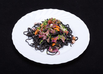 Black spaghetti with seafood and vegetables
