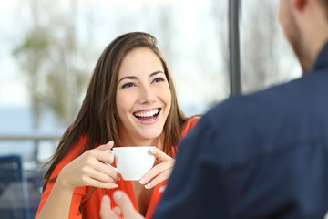 Happy woman dating in a coffee shop