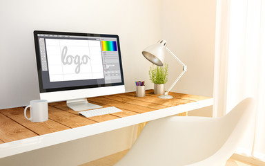 minimalist workplace with graphic design computer