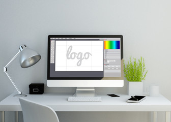 modern clean workspace with graphic design software on screen