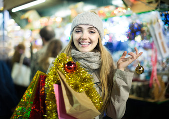 woman shopping at Christmas fair before Xmas in evening time
