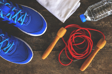 fitness lifestyle concept, sport stuff on wooden table, vintage tone [over and nature light]
