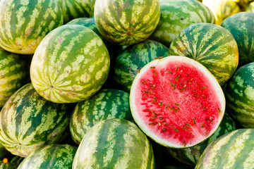 Group of fresh watermelons on market.