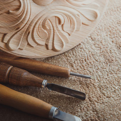 Timber, wood processing. Joinery work. wood carving with work tools close up. small depth of field. used as background