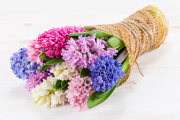 beautiful bouquet of hyacinths on a wooden background, with spac