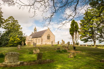 Foto auf Leinwand Befestigung St Oswald's Church Graveyard at Heavenfield in Northumberland