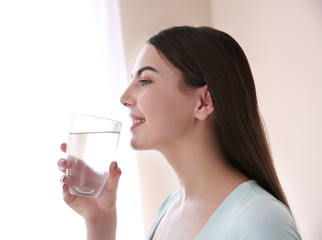 Beautiful girl drinking water