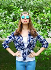 Fashion portrait hippie woman in spring flowering garden