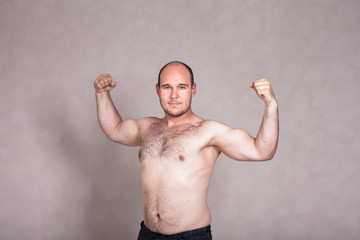 Shirtless man showing his strong arms and body