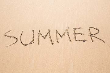summer handwritten on sand