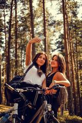Two females making selfie.