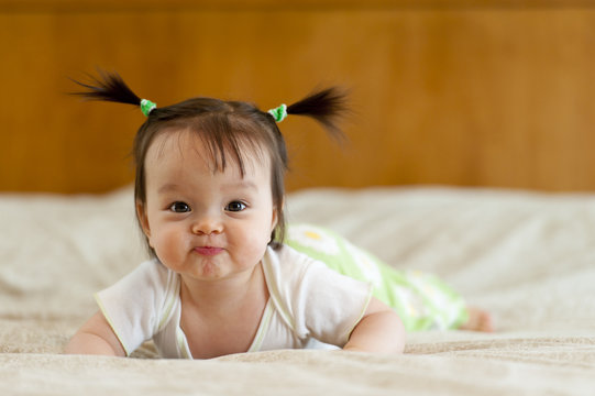 Baby tummy time with funny facial expression