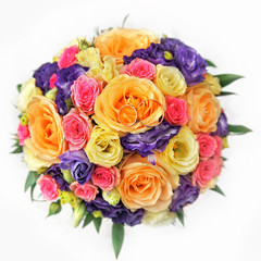 colorful rose bouquet with golden wedding rings