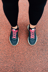 Woman's legs with running shoes