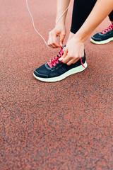 Runner preparing gym shoes
