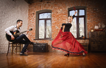 Photo Blinds Carnaval Young woman dancing flamenco and a man playing the guitar
