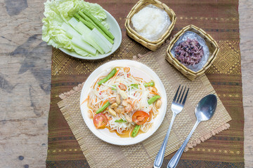 """papaya salad or what we called in Thai  """"Som Tum Thai""""  the popular Thai style local the eastern delicious food of Thailand."""