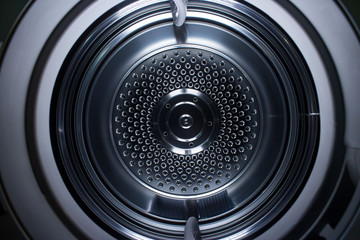 Looking inside a metal clothes dryer showing the concentric circles.