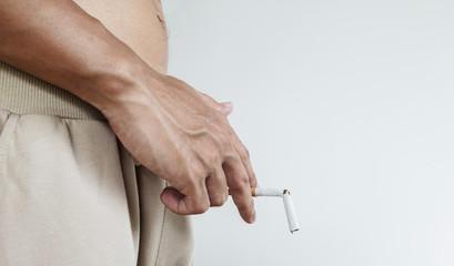 A guy holding break cigarette, concept of harmful of cigarette in sexual