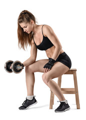 Cutout portrait of muscular young girl sitting on a chair and doing exercises.