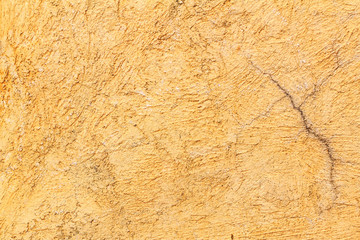 Abstract background texture cement wall in  orange yellow tone. Grunge wall texture. Cement texture and background with copy space for text or image.