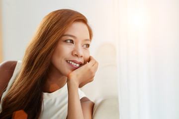 Close-up portrait of cheerful young Asian woman