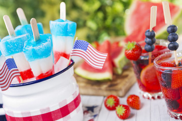 Red-white-and-blue popsicles on an outdoor table