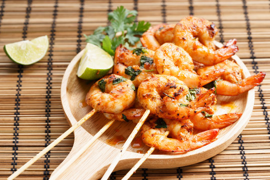 grilled shrimp kababs with sriracha and lime.