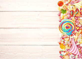 Background of wood slat table piled with sweets