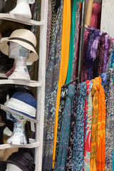 Colorful scarfs and hat on a market stall