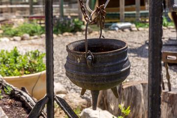 Old cast iron pot on a three legs, Israel