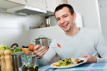 Ordinary  handsome man holding plate