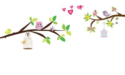 Rama de árbol con jaula y corazones.